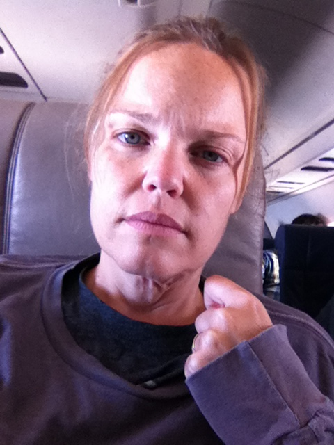 """You look like shit when your intestine perforates on a 13 hour trip to the mainland. This was taken on the flight from LA to Houston. Prior to this photo, I spent minutes curled up in a ball on the floor in the """"extra leg room row""""  at the feet of Hawaii Vulcans basketball players - due to excruciating pain that prevented me from staying in an upright position."""